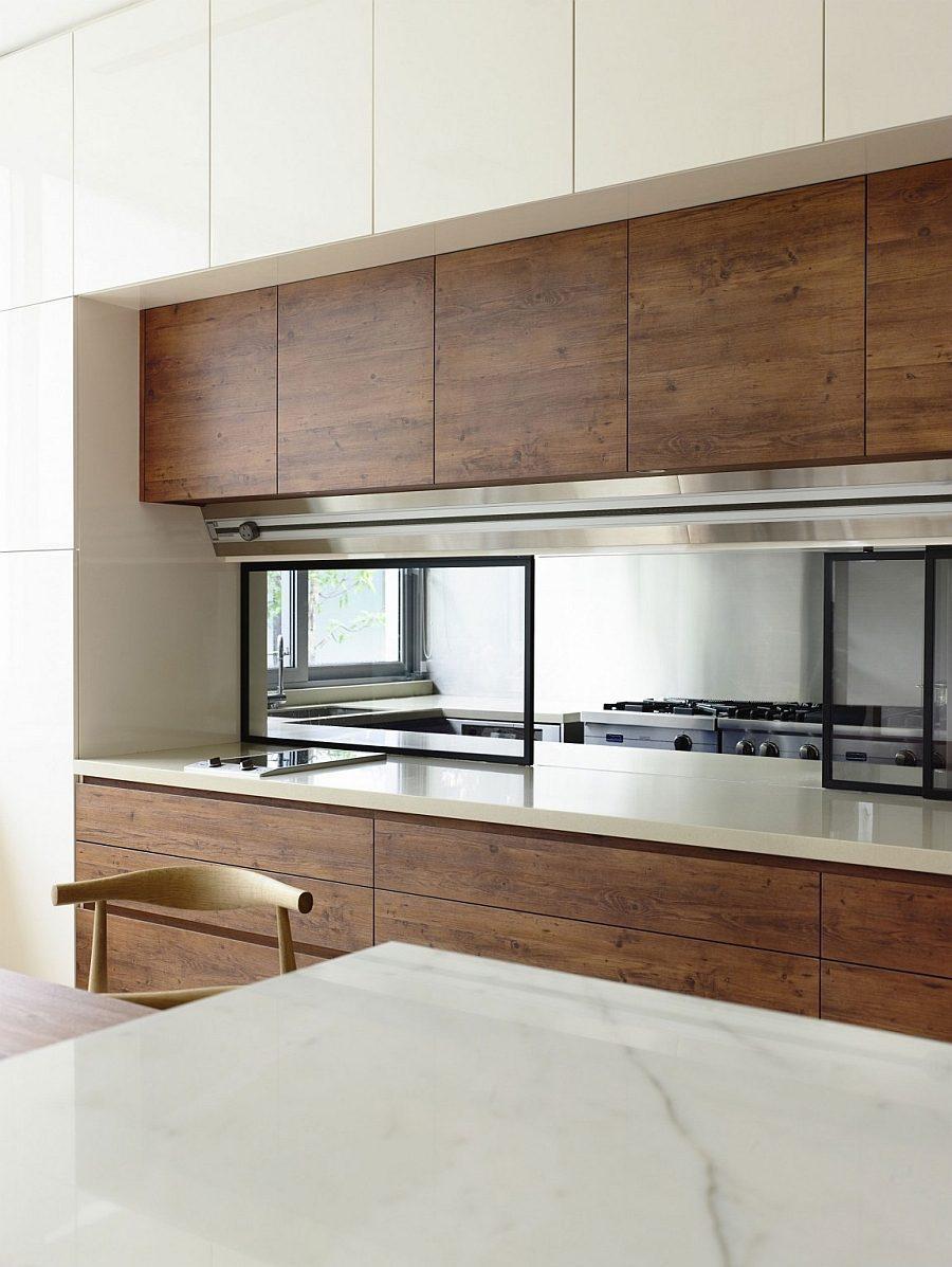 Description: State of the art kitchen exudes sleek minimalism Biệt thự tại Singapore với thiết kế không gian mở gần gũi với thiên nhiên qpdesign