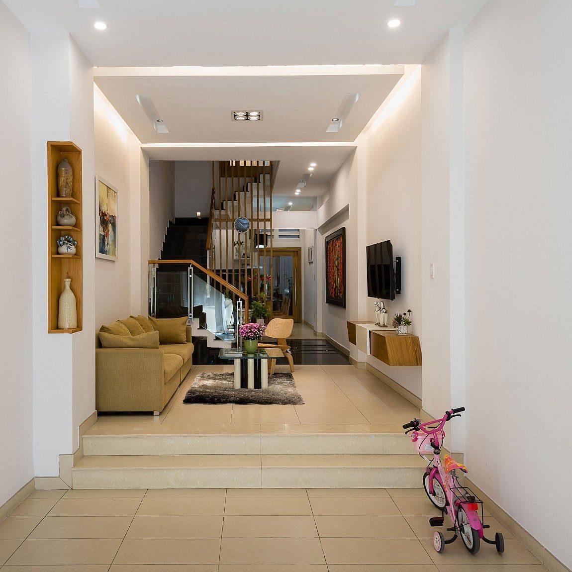 Description: Lower level living area of the modern home in Vietnam Nhà phố Sài Gòn với thiết kế giải quyết vấn đề về diện tích qpdesign