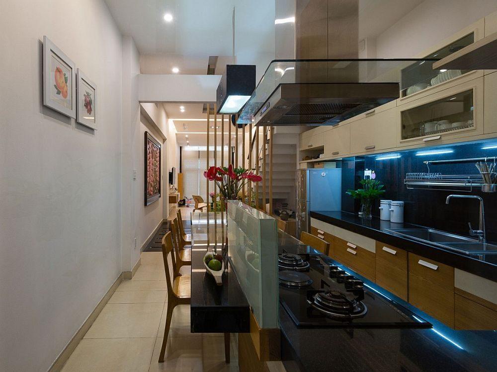 Description: View of the kitchen dining room and living area on the lower level Nhà phố Sài Gòn với thiết kế giải quyết vấn đề về diện tích qpdesign