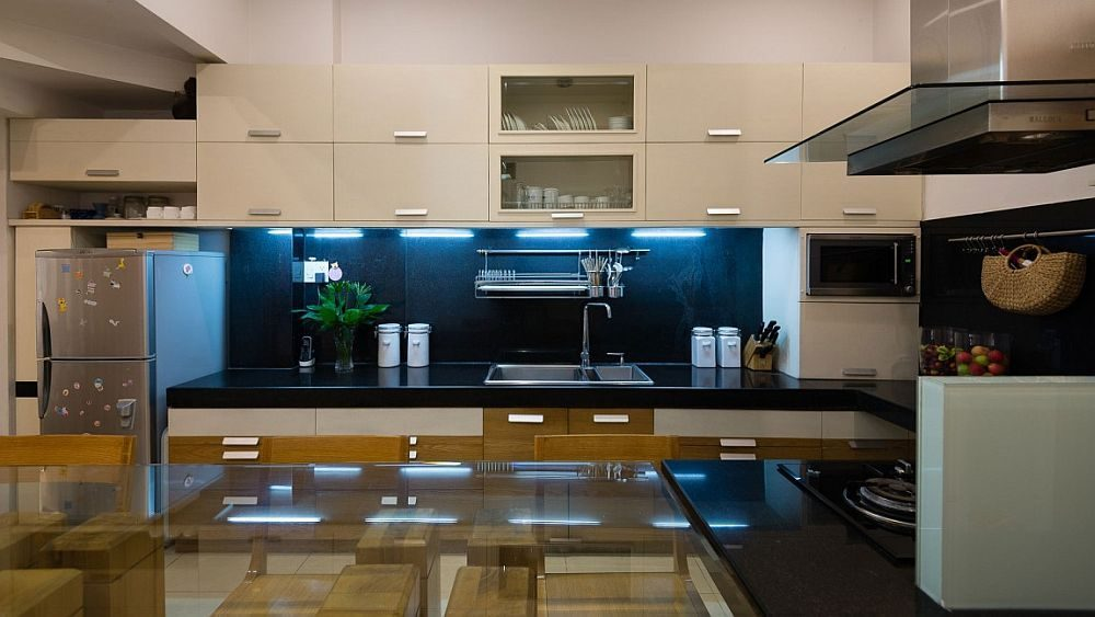 Description: White cabinets and a dark backsplash fashion a cool modern kitchen Nhà phố Sài Gòn với thiết kế giải quyết vấn đề về diện tích qpdesign