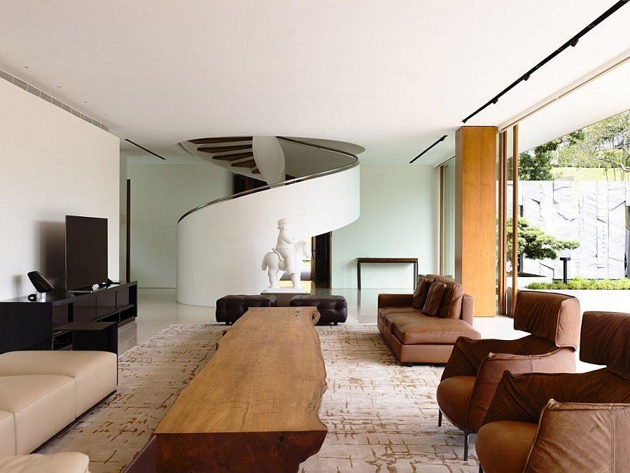 Description: Elegant and exclusive living area of the 65BTP House Biệt thự tại Singapore với thiết kế không gian mở gần gũi với thiên nhiên qpdesign