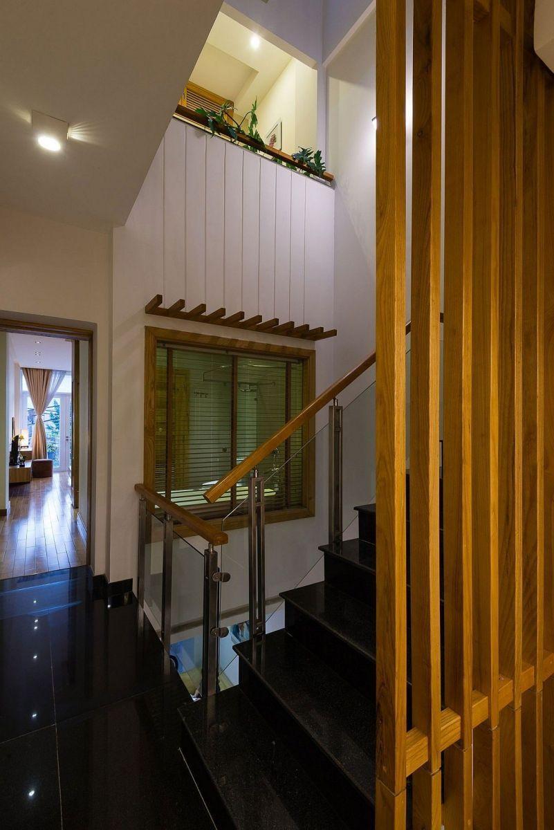 Description: Light well next to the brings illuminates the various levels of the narrow home Nhà phố Sài Gòn với thiết kế giải quyết vấn đề về diện tích qpdesign