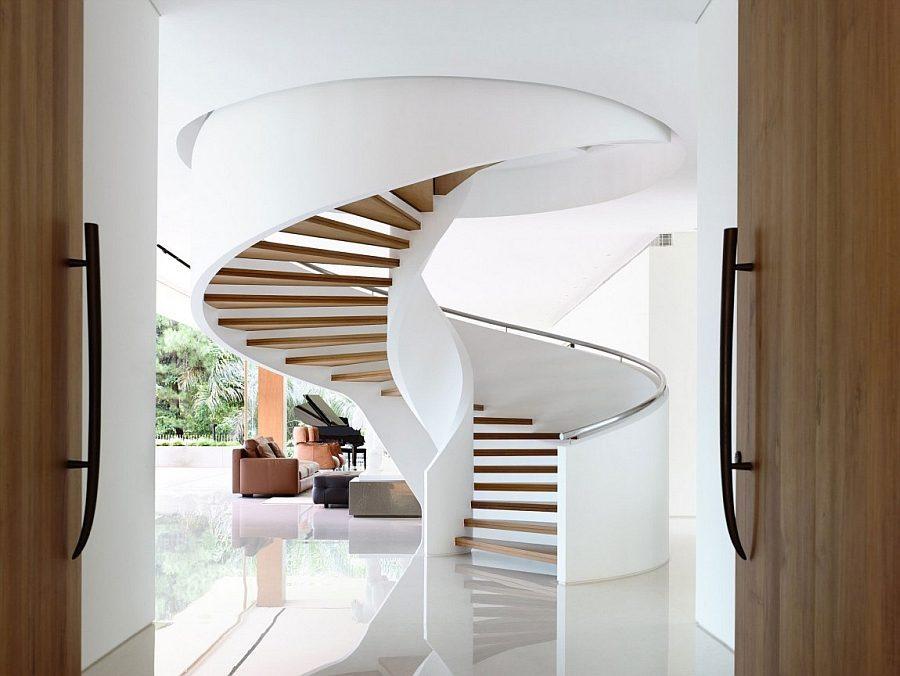 Description: Stunning spiral staircase at the entrance of the house Biệt thự tại Singapore với thiết kế không gian mở gần gũi với thiên nhiên qpdesign